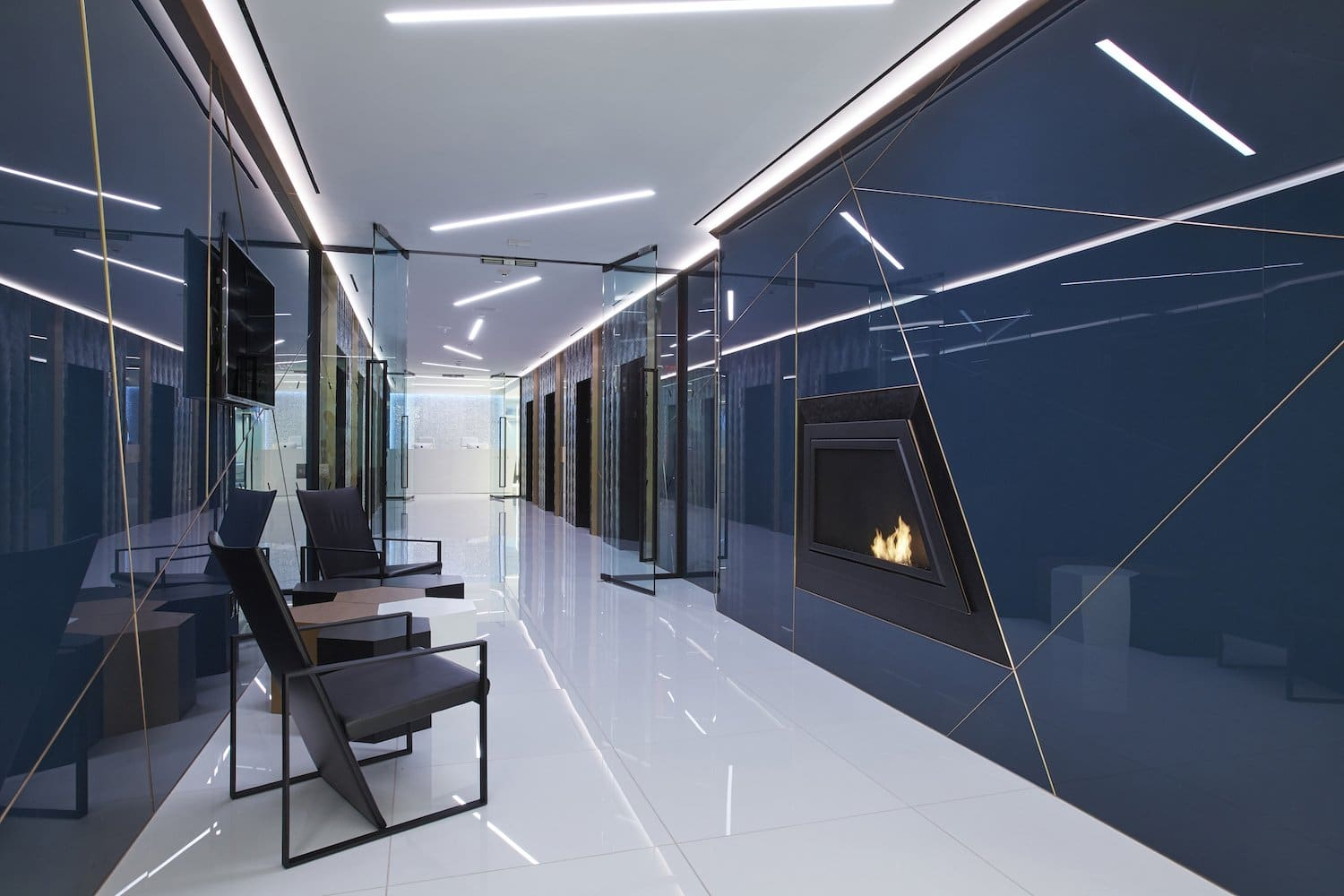 Hallway with fireplace and sitting area