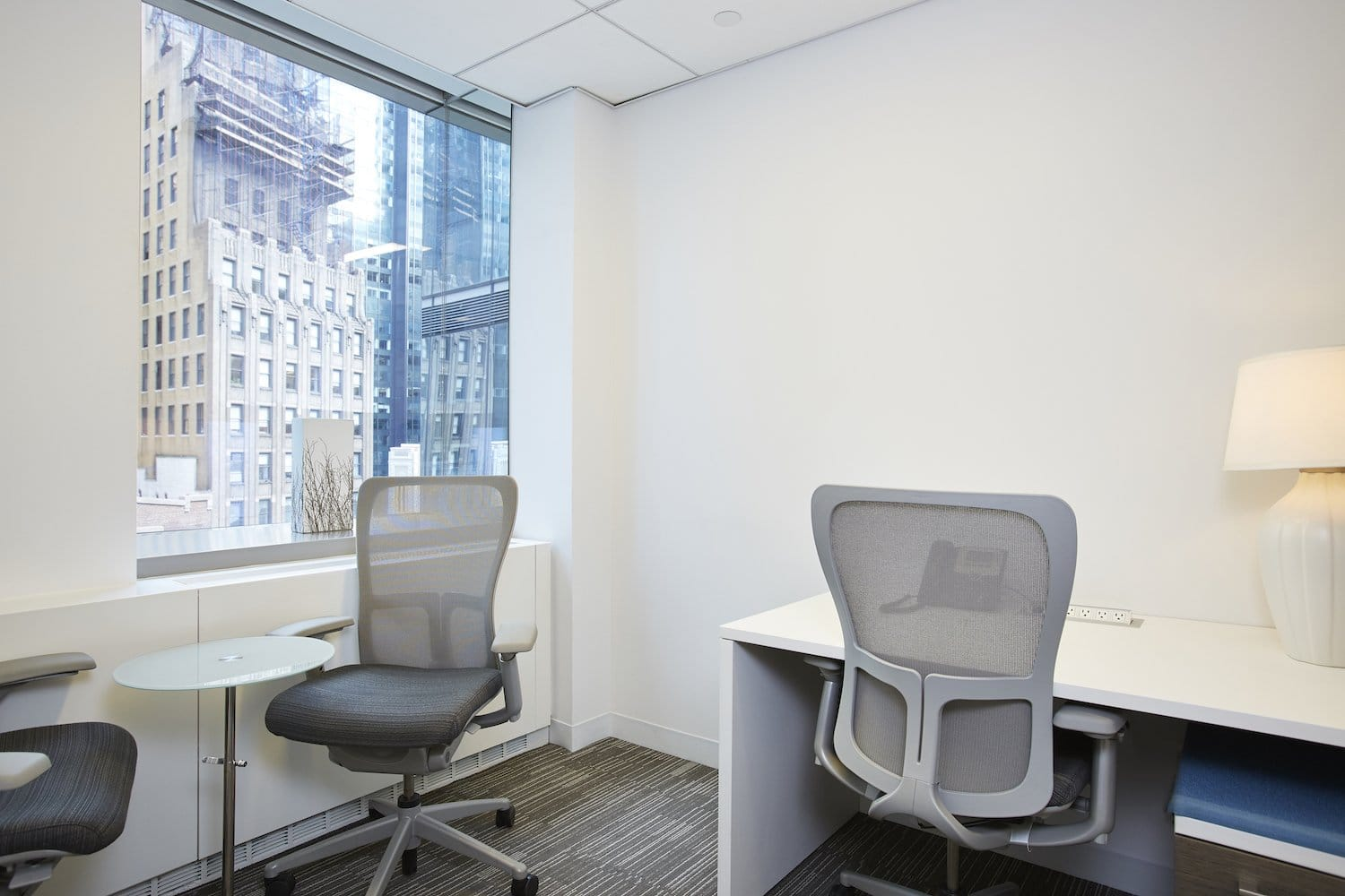 Shared office space with a window